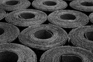Close up rolls of black felt