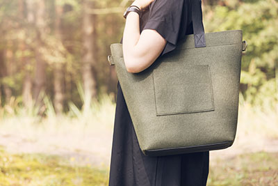 A beautiful felt bag on a woman's shoulder