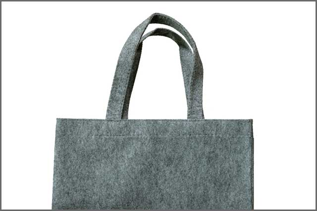 Simple felt bag with straps shown