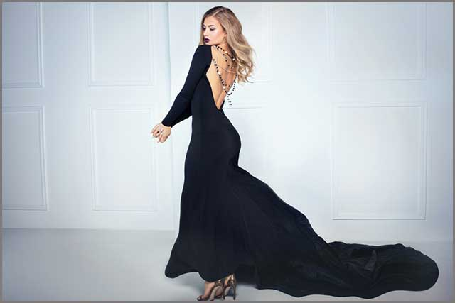 A blonde women wearing the long black dress